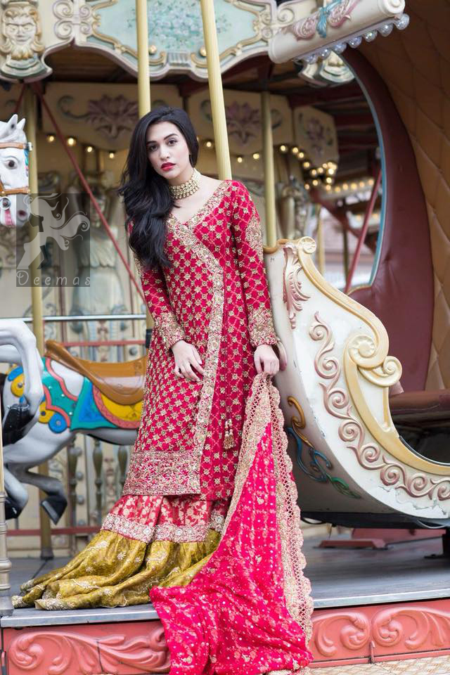 Gown adorned with dull golden and antique shades of embellishment. Pure banarsi chiffon jamawar dupatta having embellished border and small motifs spray. Pure banarsi chiffon jamawar gharara in Cardinal Pink and Mehndi Green.