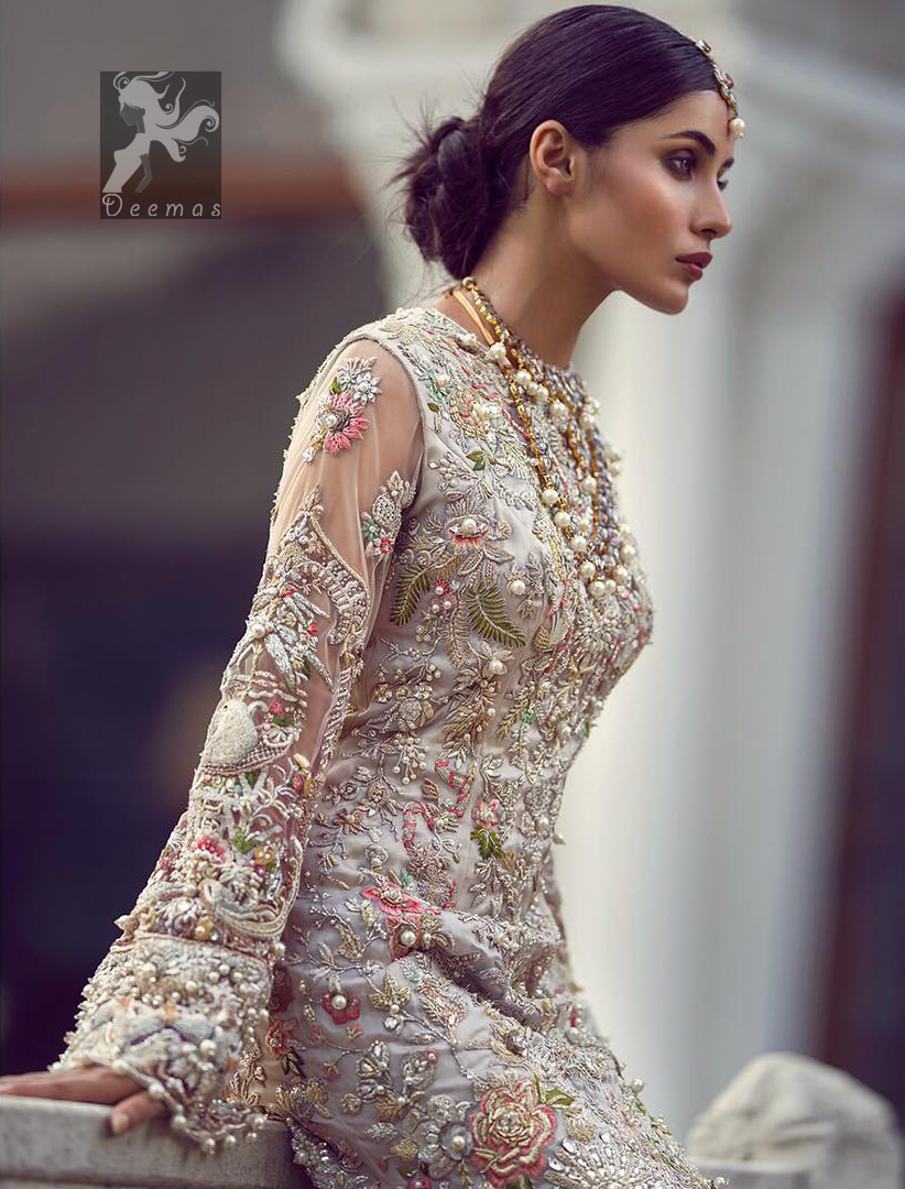Ivory white long fitted bridal maxi. Maxi adorned with colorful embellishment using appliques and threads. Bridal maxi comes with two tones dupatta having peach and ivory white shades.