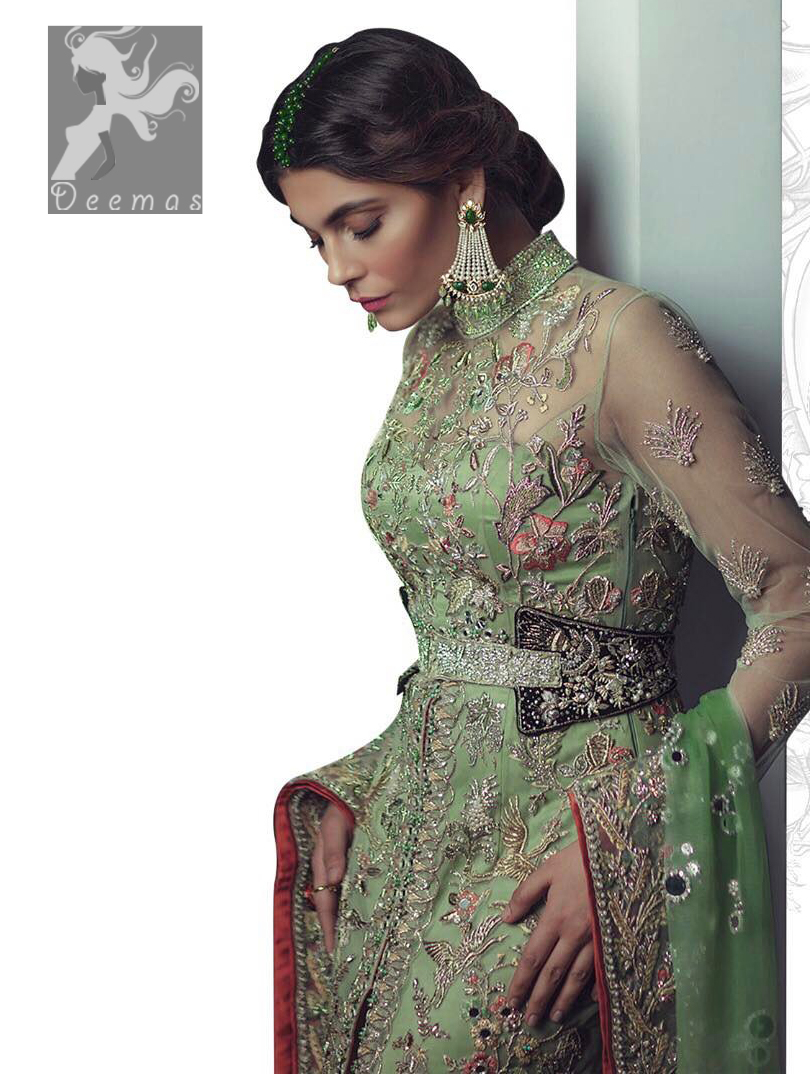 Pistachio green gown having high neck gown. Embellished Bodice with waist belt and front open slits. Mehndi green trousers having embellishment on cuffs and motifs. Pistachio green net dupatta having embellished border and round motifs all over it.