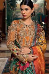 A jaffa color shirt heavily embellished in the front with antique shaded kora dabka, kundan, tilla, sequins and pearls. Floral motifs on the shirt and cold shoulder sleeves enhance the beauty of this shirt. It is finished with scalloped embellishment border. This dress is coordinated with embroidered cigarette pants and self-printed dupatta.