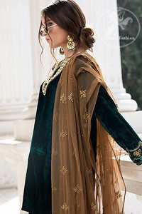 Take a step towards refreshing your wardrobe with bottle green velvet Shirt. The shirt is perfected with delicate gold tilla work. Add this bottle green velvet golden embellished bell bottom for a complete look. It comes with golden net dupatta enhanced with small motifs on the ground.