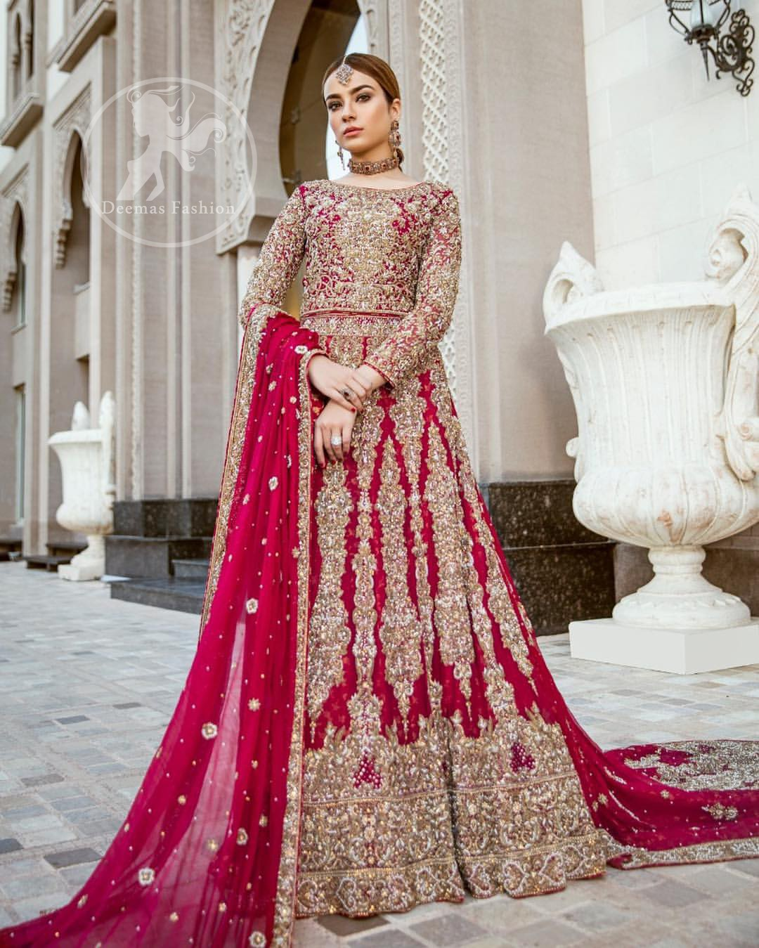 Delicately crafted and personifying chic elegance with an element of grandiose. Heavily embellished in the front with intricate embroidered pattern done with dull golden kora, dabka, kundan, tilla and sequins. The lehnga with embroidered motifs pattern all over and finished with thick kora and dabka borders completes the look. It is coordinated with tissue dupatta which is sprinkled with sequins all over it. It is further furnished with four sided embroidered border.