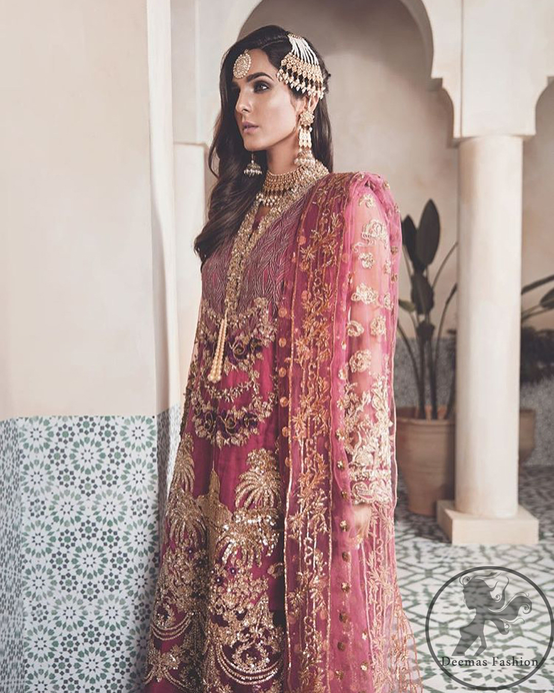 A picture of pure elegance with our net tapestry shirt enhanced with embellished neckline. The daaman is further highlighted with embellished scalloped border. It is paired up with embellished trousers adorned with beautiful motifs. It comes with net dupatta having four sided embroidered border and sprinkled with sequins all over it.