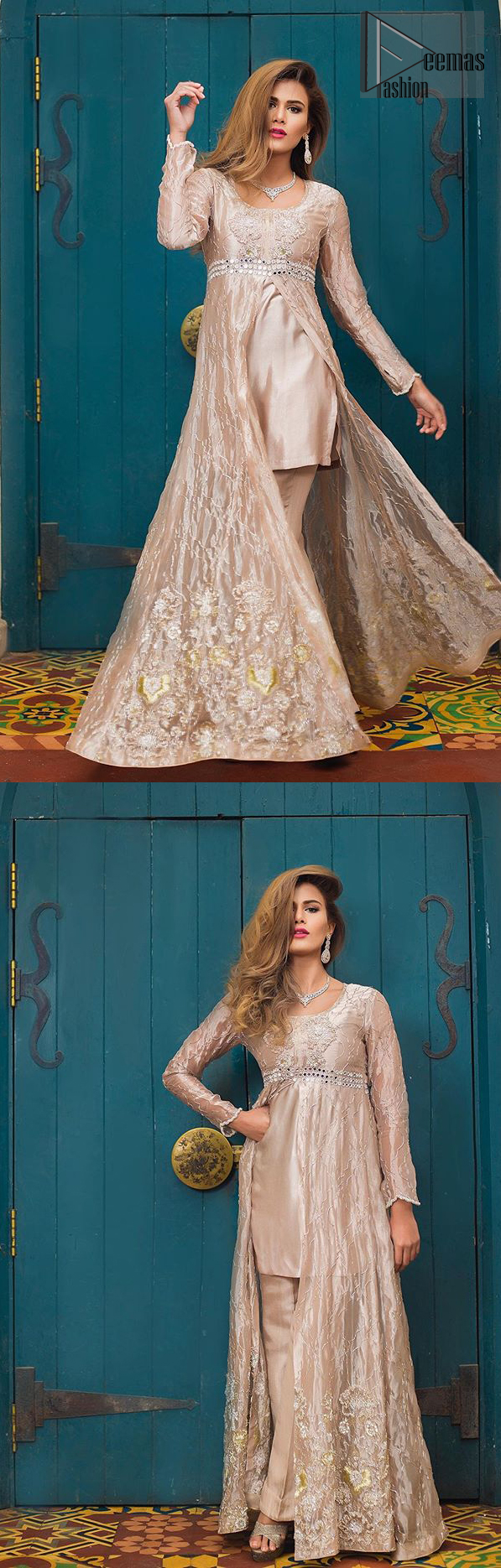 This dress is majestic beauty. Delicately crafted and personifying chic elegance with an element of grandiose. The gown is beautifully decorated with floral bunches done with silver kora, dabka, tilla and sequins work. The bottom of the gown is enhanced with rich floral embroidery. Style it up with hand embellished fixed waist belt. It comprises with cameo straight pantsa. This outfit is coordinated with chiffon dupatta having sequins spray all over.