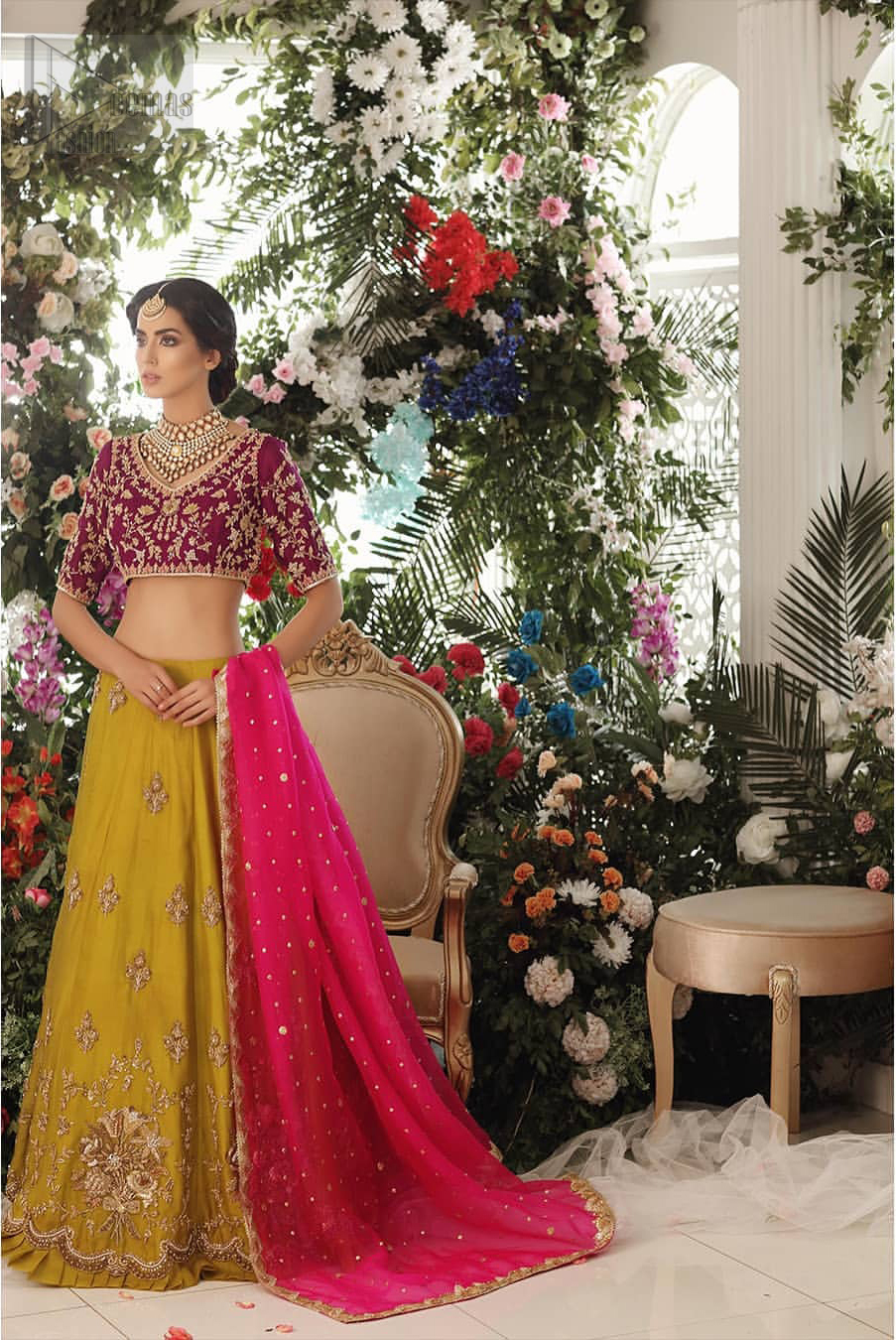 Adorn yourself with this breath-taking mehndi lehenga outfit. This beautiful mehndi dress comes with yellow lehenga with scattered beautiful embellished motifs and floral booties around a large central motif and it finished with frilled border. It is coordinated with a beautiful plum blouse adorned with zardozi work in the shades of golden and silver. Style it up with pink organza dupatta with sequins sprayed all over it along with gota finishing on all four sides.