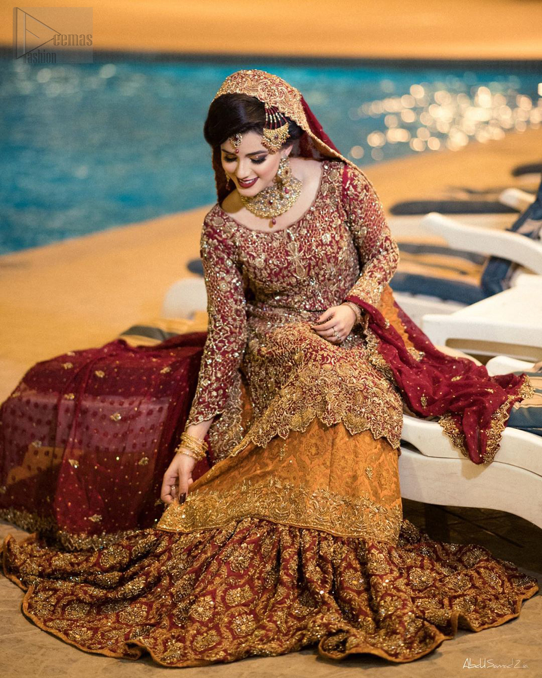 You are all set to make a lasting impact with the divine royalty of this dress. This ravishing ensemble is sure to make you look like glamorous royalty with immaculate work covering every inch of the shirt. It boasts a pretty scallop hemline and full sleeves with zardozi embellishment. Compliment the look with flared lehenga. The combination of rust with maroon is absolutely breathetaking. Elegance is personified when it gets paired up with an all-over sequins spray on dupatta dupatta with alternating scalloped borders detailing. This is an ensemble that deserves to be flaunted.