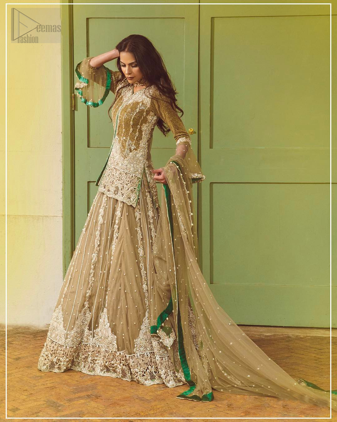 Let the crowd stare and make it worth their while when you walk wearing this outfit. Designed to flaunt your best features, the front open shirt carries intricate embellishment on the hemline and neckline. Complete the look with artfully coordinated lehenga which is ornamented with a bold and captivating design with a traditional intricate embroidery. Furthermore the lehenga and shirt is also emphasized with silver embroidered vertical lines. The fawn net dupatta with chann and scalloped finishing all around the edges makes the look complete. Upholding the idea of simple is beautiful, you would definitely want to wear this for your next occasion.
