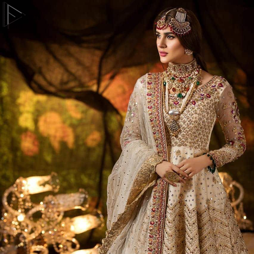 Delicately crafted and personifying chic elegance with an element of grandiose. This outfit is beautifully sculptured with geometric embroidery, adorned with heavy embellished bottom with golden and antique shaded kora, dabka, pearl and sequins work all over. Furthermore the outfit is emphasized with colorful thread work and mukesh embroidery. It is coordinated with ivory dupatta with sequins sprayed all over it along with zardozi work all around the edges to make the look complete.