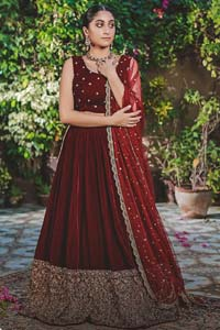 Let the crowd stare and make it worth their while when you walk wearing this maroon velvet lehenga blouse. Designed to flaunt your best features, the sleeveless blouse carries sequins spray with round neckline. Upholding the idea of simple is beautiful, you would definitely want to wear this for your next occasion or on your big day. The blouse is paired with maroon lehenga with hand embellishments on velvet base. The wide flare lehenga hemline is emphasized with intricate details with antique shaded kora, dabka, tilla and sequins work that gives the perfect ending t this outfit. Paired with maroon net dupatta having lace on all four sides.