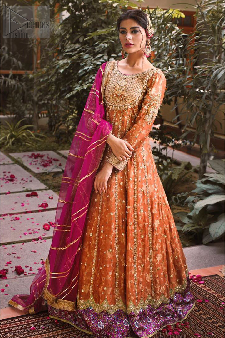 Let the crowd stare and make it worth their while when you walk wearing this anarkali frock. Designed to flaunt your best features, the bodice carries intricate zardozi work. Furthermore this multiple panel frock is enhanced with gota work and beautiful applique on bottom embellished with golden kora, dabka, tilla, sequins and beads work. Pair it up with pink churidar pajama and pink organza dupatta emphasized with gota work and four sided kiran lace. Upholding the idea of simple is beautiful, you would definitely want to wear this for your next occasion.