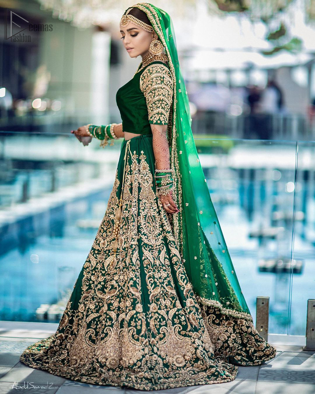 This artisanal piece is rendered in grace and timelessness. This outfit makes a statement in this stunningly floraison, perfect blend of glamour and tradition with outstanding craftsmanship and gorgeous detailing. This mehndi dress in a dreamy shade of green, enhanced with hand embellishments on neckline and sleeves. The wide flared lehenga is an example of remarkable handiwork with a lot of attention to detail. The sculptured embroidery is in the shade of golden. Complete the look with bottle green organza dupatta emphasized with tiny floral motifs on the ground and four sided embellished border.