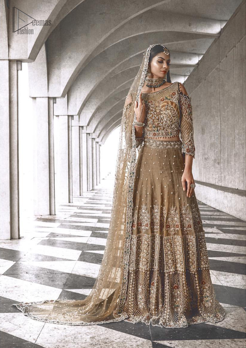 This mehndi green outfit totally pulled off our classic bridal wear with an unmatchable grace giving major bridal goals. Featuring beautiful handwork, the blouse has a delicate arrangement of hand embellished floral patterns with zardozi work and finished with dangling balls. Refined craftsmanship is at its best with hand embellished jaal, geometric patterns and floral bunches at the lehenga. This outfit is paired with an organza dupatta chann and finishing all around the edges making it a statement piece.