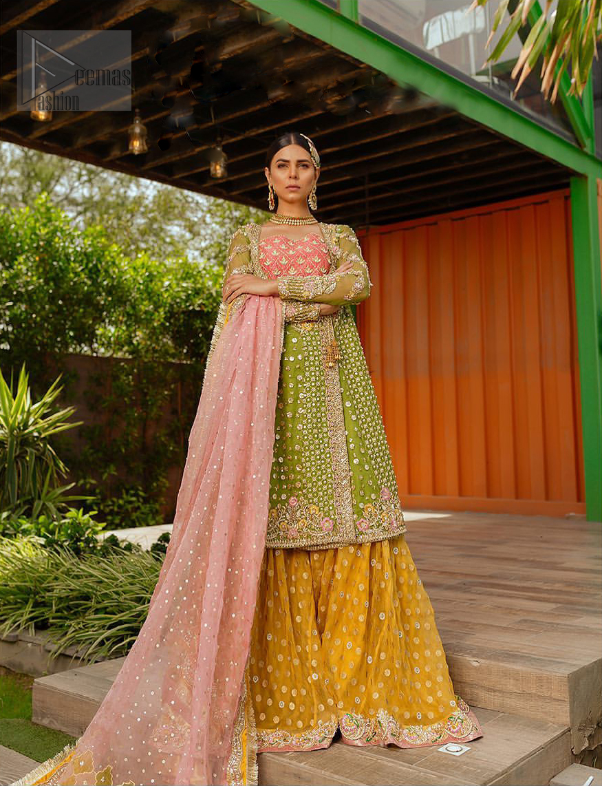 We have brought a charismatic charm to the traditional motifs and cuts. Our embroidery is rich in detailed traditional techniques executed to perfection. The bride shines bright in this outfit, embedded with sophisticated zardozi and thread embeishments. The bodice and hemline is furthermore emphasized with intricate details that gives the perfect ending to this mehndi dress. Pair it up with yellow sharara with captivating embellished border. The dupatta incorporates beautifully designed borders with zardozi, applique and kiran along the length, focusing on the geometrically embellished pallu and sequins spray all over to give it a perfect look.