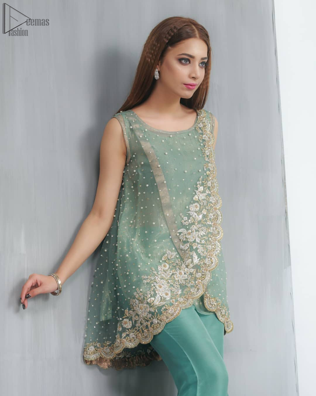 This outfit should be the next addition to your wardrobe. Gussy up the glamour with this intricately embroidered Sea Green ensemble accentuated with floral motifs and finished with scalp borders. An example of beauty and elegance. Look breathtakingly stylish in this embroidered regalia furnished.