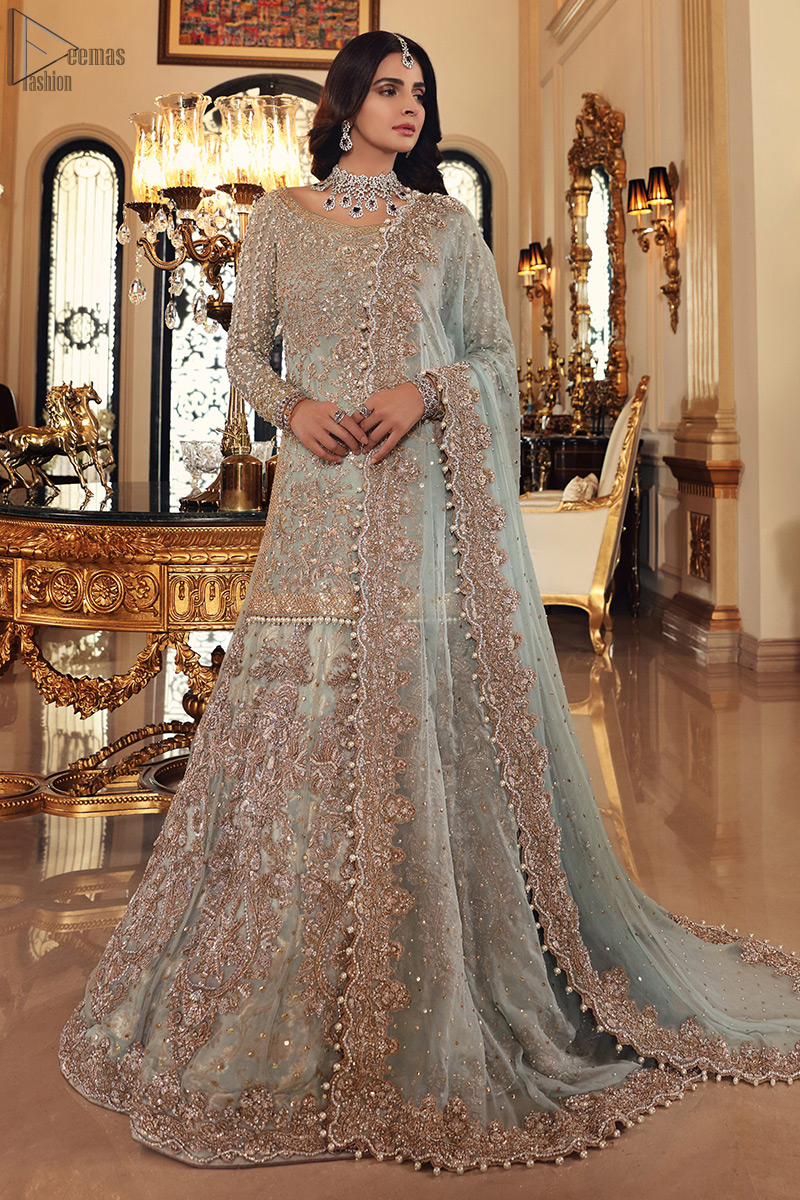 This colour is the perfect feminine and delicate shade with its meticulously crafted fabrication with the flow of organza dusted with pearls to the richness of the shirt and dupatta pallu bordered with gorgeous embroideries. Adorned with sterling sequences and silver and crystal hand embellishments, its a classic modern masterpiece. Lehenga is emphasized with two layers of fabrics, the inner layer is of banarsi and the upper layer is fully embellished with zardozi work. Embroidery is done in the shades of antique and silver. The outfit is complemented with a mint green dupatta with chann all over and finishing with handwork borders all around the edges.