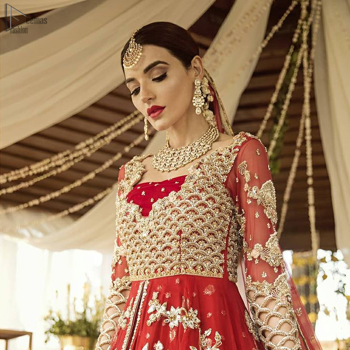 Pakistani Bridal Wear - Red Front Open Back Train Maxi. The outfit is coordinated with an organza dupatta with hand-embroidered borders on all four sides and gota sequin work on the ground.