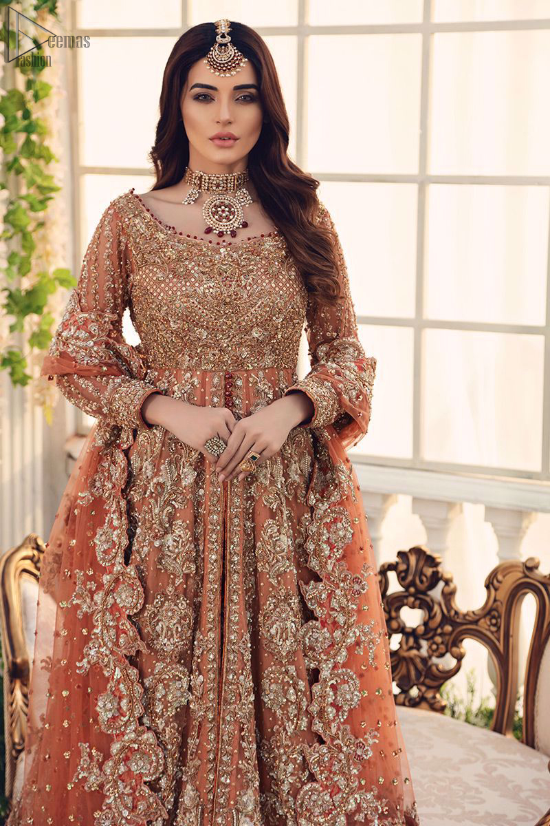 Pakistani Bridal Wear Salmon Front Open Gown - Maroon Back Train Lehenga - The front open dreamy gown is adorned with an embellished bodice, sleeves and embroidered daaman is giving a perfect ending to this flare.